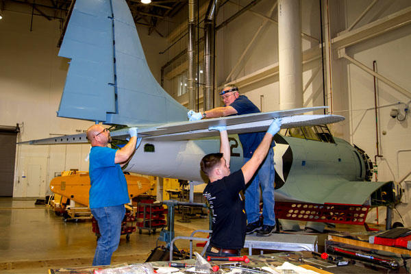 The National Museum of the Marines Corps is now exhibiting a World War II-era Douglas SBD-3 Dauntless dive bomber recovered from Lake Michigan. Workers spent about 63,000 hours restoring the aircraft. (US Marine Corps photo)