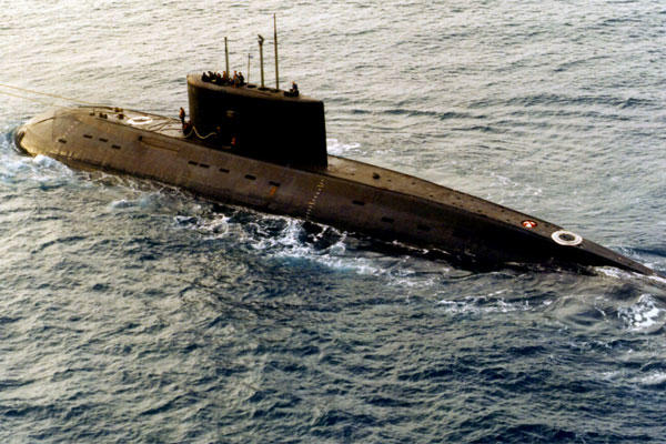 A Soviet-era, Kilo-class diesel submarine is towed by a support vessel in the central Mediterranean Sea in December 1995. Ships and aircraft from the U.S. Navy's Sixth Fleet tracked the sub, which had been sold to Iran. (DoD photo))