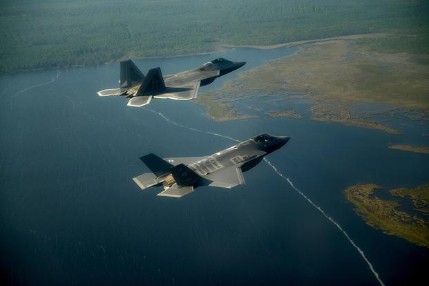 An F-22A Raptor (top) from the 43rd Fighter Squadron at Tyndall Air Force Base, Fla., and an F-35A Joint Strike Fighter from the 33rd Fighter Wing at Eglin Air Force Base, Fla., fly in formation on Sept. 19, 2012. (US Air Force photo/Jeremy  Lock)