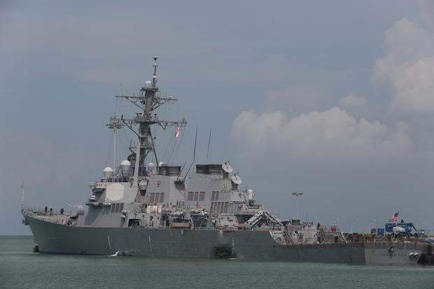 USS John S. McCain (DDG 56) moored pier side at Changi Naval Base in Singapore following a collision with the merchant vessel Alnic MC east of the Straits of Malacca and Singapore on Aug. 21, 2017. (U.S. Navy photo/Grady T. Fontana)