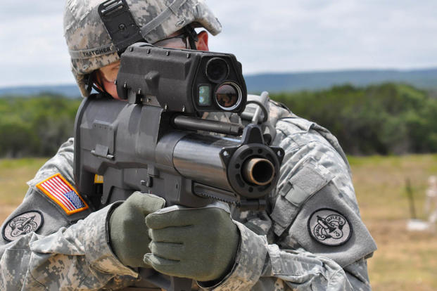 A soldier aims an XM25 Counter Defilade Target Engagement weapon system at Aberdeen Test Center, Md. Army photo