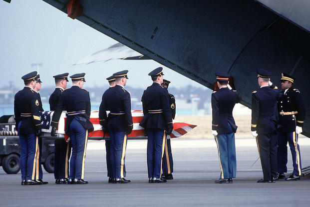 Major Nicholson's casket being placed on a U.S. aircraft at Rhein-Main Air Base in Germany. (U.S. Army photo by Staff Sgt. David Nolan)