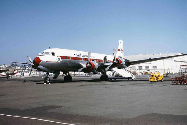 A Saturn Airways DC-6B at the San Diego International Airport - Lindbergh Field. 1 September 1963 (Photo: Wikimedia Commons/Jon Proctor)