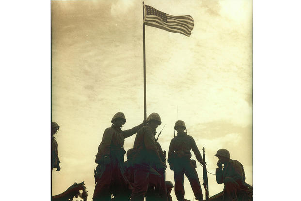 The Marine Corps is updating its historical records to identify who participated in the first flag-raising atop Mount Suribachi during World War II. Photo by Staff Sgt. Lou Lowery. Courtesy Marine Corps History Division