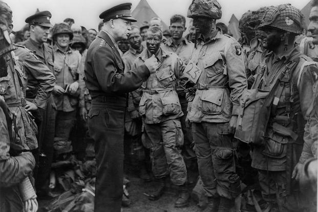 "Gen. Dwight D. Eisenhower gives the order of the day, ""Full victory - nothing else,"" to paratroopers in England, just before they boarded their airplanes to participate in the first assault in the invasion on June 6, 1944."