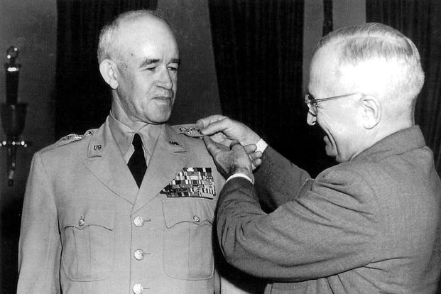 President Harry S. Truman promotes General Omar Bradley to five-star rank, 22 September 1950.