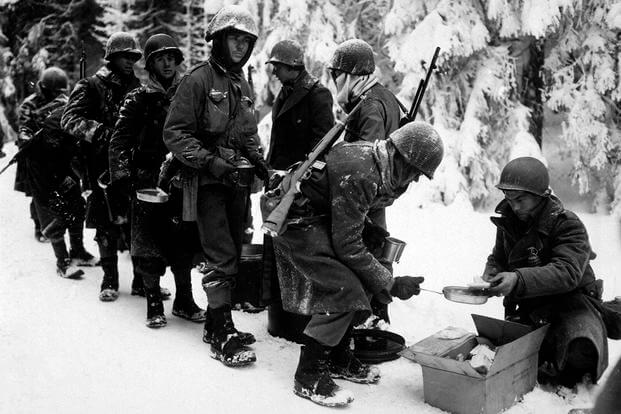 Chow is served to the 347th Infantry Regiment in, Belgium, January 13, 1945, during the Battle of the Bulge. (National Archives photo)