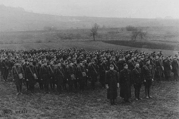 Officer s and enlisted men of the AEF Signal Corps Radio Section gather for a photograph after the Armistice, 1 December 1918. Major Loghry is on the left of the first row. (Photo: National Archives)