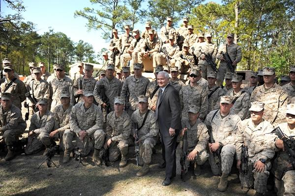 Defense Secretary Robert M. Gates visits Marines stationed at Camp Lejeune, N.C., in April 2009. Many veterans who served   there have filed disability claims with VA because the camp's water supply contained toxins. (US Air Force/Jerry Morrison)