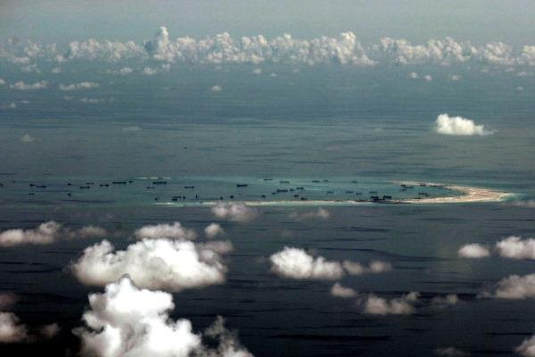 China's island-building in the the South China Sea may soon quadruple the number of airstrips available to the People's   Liberation Army in the highly contested and strategically vital region. (AP photo)