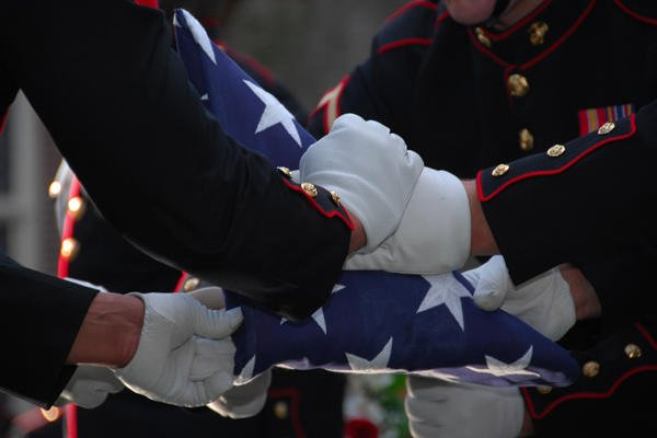 Flag folding for military funeral.