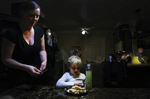Heather Drain serves dinner to her son.