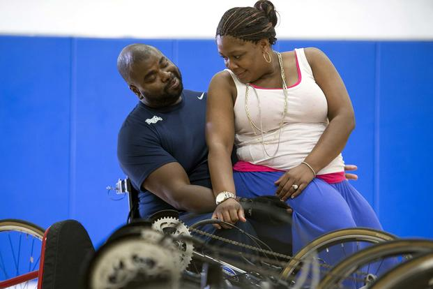 Shundra Johnson, right, and her husband Coast Guard Lt. Sancho Johnson share a moment during the Navy's wounded warrior training camp for the 2015 DoD Warrior Games in Port Hueneme, Calif., May 29, 2015. (DoD News photo by EJ Hersom)
