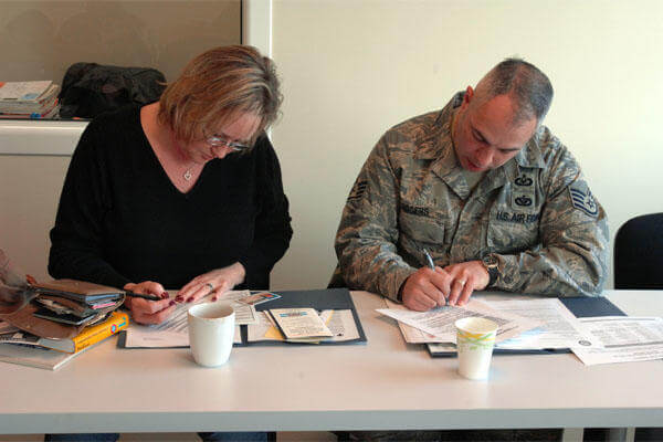 airman and spouse fill out paperwork