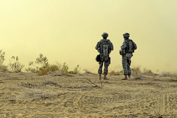 Two soldiers patrolling the desert.