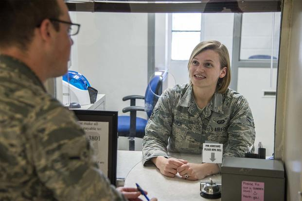 Airman 1st Class Bridget Golden, 502nd Comptroller squadron cashier, assists a customer with military pay June 23, at JBSA-Lackland. (Photo by Johnny Saldivar)