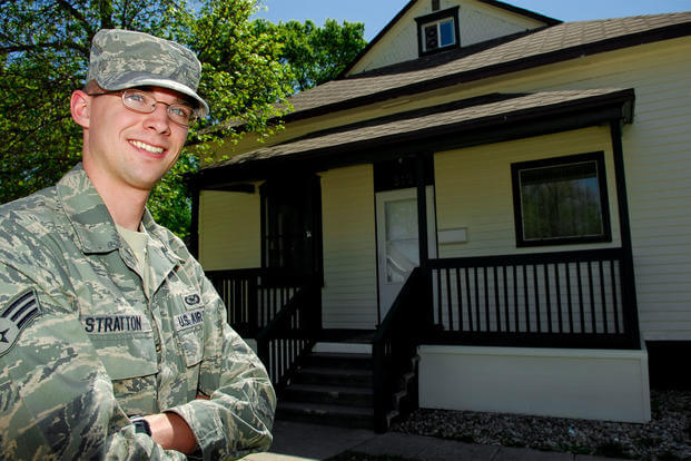Senior Airman Benjamin Stratton, 5th Bomb Wing public affairs, poses for a photo outside his newly purchased home, May 18, 2010. (Photo: U.S. Air Force)