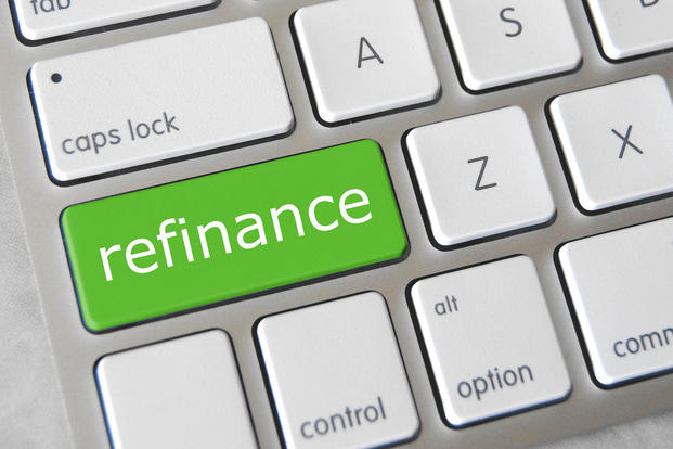 Laptop with Refinance key (Photo: Flickr/Jake Rustenhoven, GotCredit)