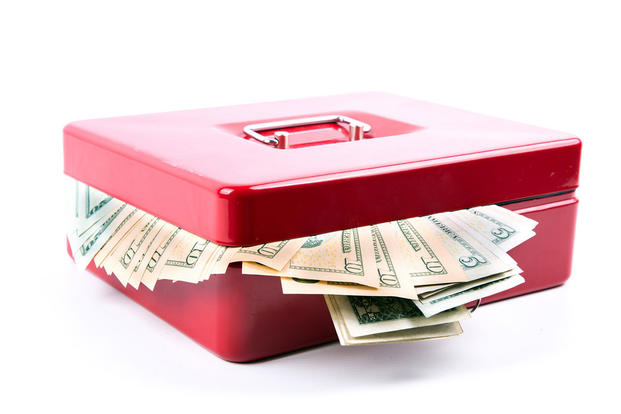 Cash box with money sticking out