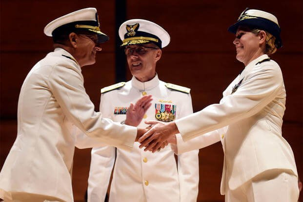 Incoming U.S. Coast Guard Academy superintendent Rear Adm. James E. Rendon shakes hands with his predecessor; newly promoted U.S. Coast Guard Vice Admiral Sandra L. Stosz, June 1, 2015. (Sean D. Elliot/The Day via AP)