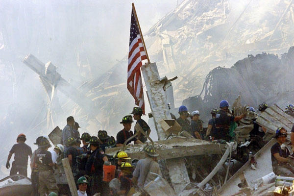 An American flag flies over the rubble of the collapsed World Trade Center buildings in New York on Sept. 13, 2001. (AP photo)
