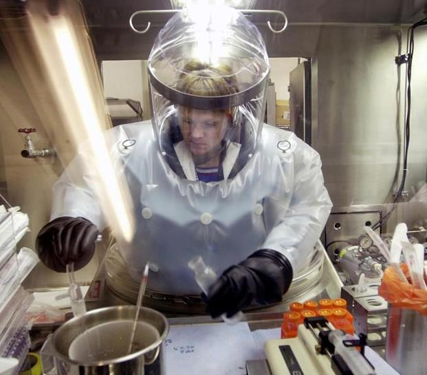 Microbiologist Ruth Bryan works with BG nerve agent simulant in Class III Glove Box in the Life Sciences Test Facility at Dugway Proving Ground, Utah. (AP Photo/Douglas C. Pizac)