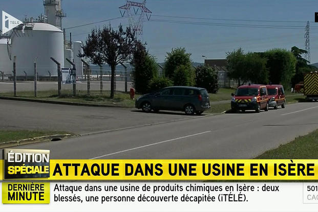 In this screen grab taken from video provided by I Tele, emergency services sit at the scene outside a factory where a man was allegedly beheaded, in Saint-Quentin-Fallavier, France, Friday, June 26, 2015. (I Tele via AP)