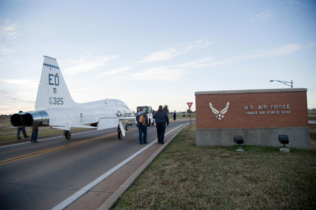 Members of the aircraft maintenance section, help move a T-38 Talon Nov. 1 out of the Vance Air Force Base, Oklahoma west gate and transport it to the main gate to be displayed as a static. (U.S. Air Force photo/Staff Sgt. Nancy Falcon)