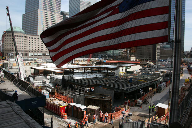 An American Flag flies near the Ground Zero construction site. (U.S. Marine Corps/Sgt. Steve Cushman)