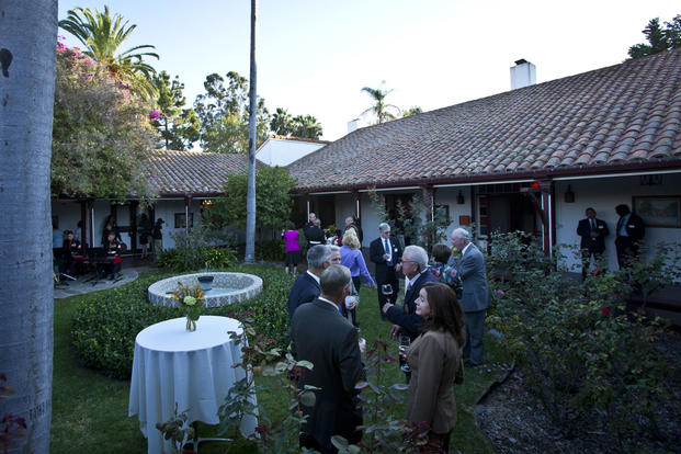 U.S. Marines and local government officials gather at the Santa Margarita Ranch House aboard Camp Pendleton, Calif., Oct. 9, 2014, during the annual Evening Colors ceremony. (U.S. Marine Corps photo/Sgt. Melissa Marnell)