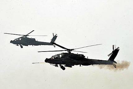 Army Apache helicopters participate in exercise to mark Korean War anniversary