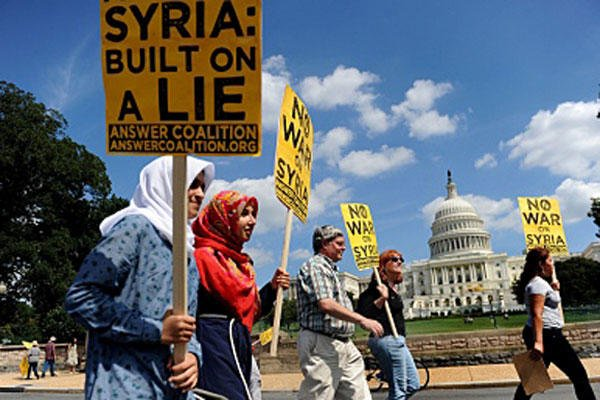 Demonstrators march past the U.S. Capitol in Washington, D.C., protesting U.S. intervention in Syria.