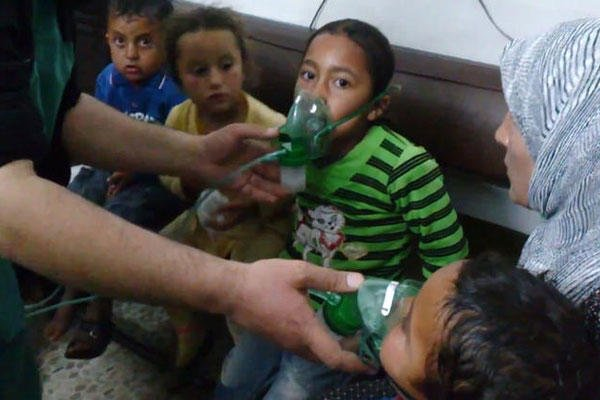 In this image taken from video, children are seen receiving oxygen in Kfar Zeita, a rebel-held village in Hama province 125 miles north of Damascus. (AP Photo/Shaam News Network)
