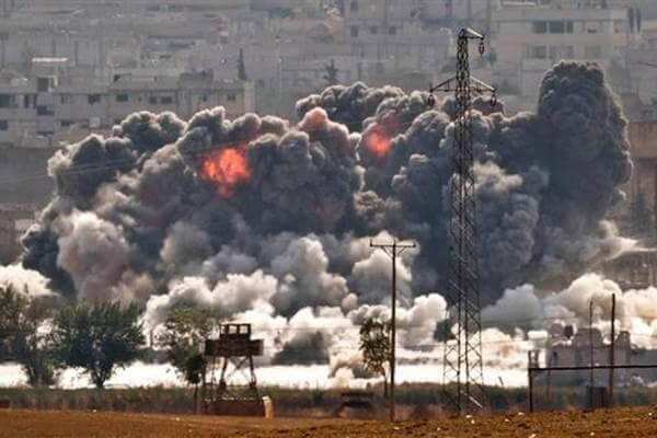 Smoke and flames rise from an Islamic State fighters' position in the town of Kobani. (AP Photo)