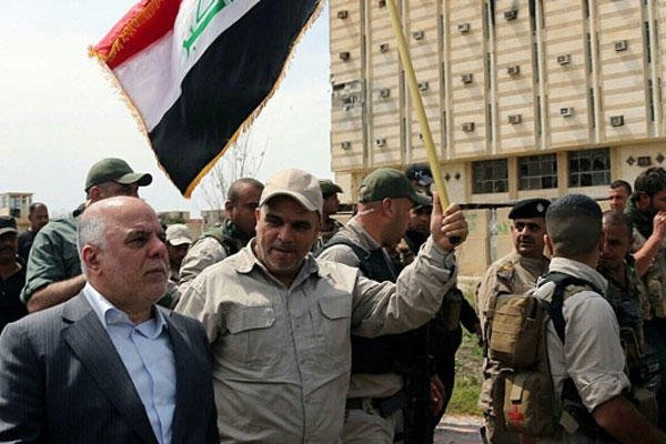 Iraqi Prime Minister Haider al-Abadi tours the city of Tikrit after it was retaken by the security forces in Baghdad, Iraq, Wednesday, April 1, 2015. (AP Photo)