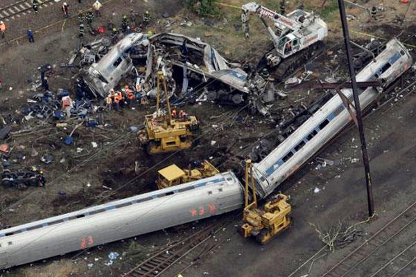 Emergency personnel work at the scene of a deadly train derailment, Wednesday, May 13, 2015, in Philadelphia. (AP Photo/Patrick Semansky)