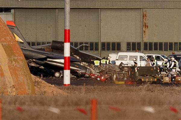 FILE - A Tuesday, Jan. 27, 2015 file photo showing investigators working around the wreckage of planes the day after a Greek F-16 jet crashed at Albacete airbase, Spain. (AP Photo/Daniel Ochoa de Olza)