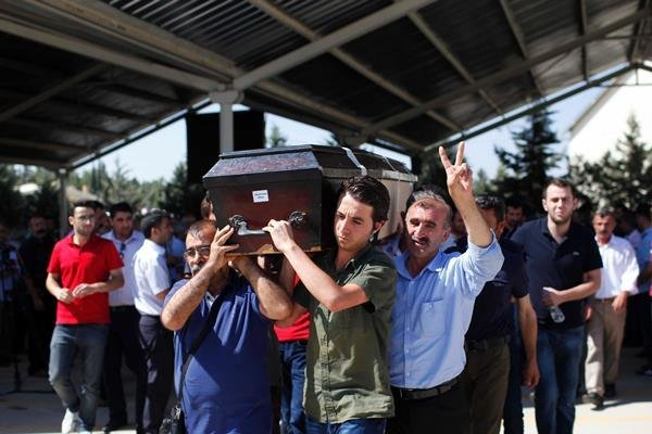 Mourners carry a coffin during a funeral ceremony for the victims of a suicide bomb attack in southern Turkey that killed 32 people. ISIS militants are suspected to be behind the blast. (Gokhan Sahin/Getty Images)