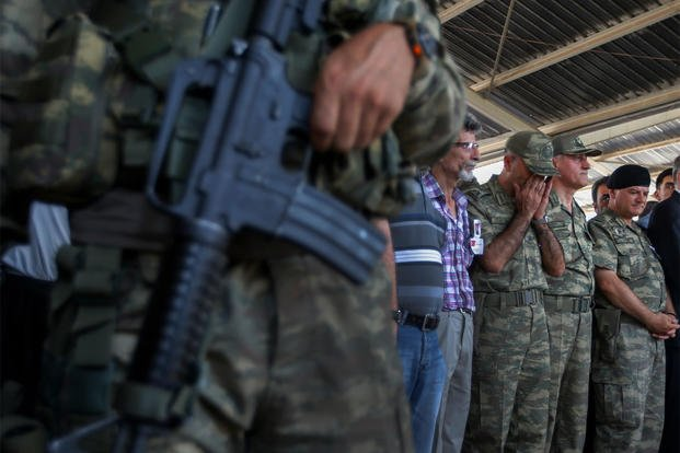 Turkish soldiers pray during the funeral of slain soldier Mehmet Yalcin Nane in the town of Gaziantep, southeastern Turkey, Friday, July 24, 2015 (AP Photo/Emrah Gurel)