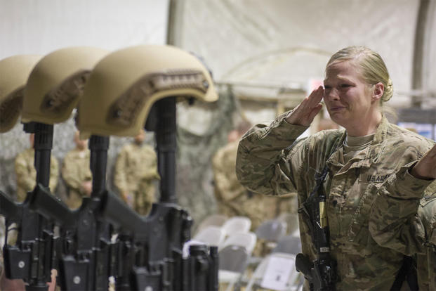 Service members from several units at Bagram Airfield, Afghanistan, pay their respects during a fallen comrade ceremony held in honor of six Airmen Dec. 23, 2015. (U.S. Air Force photo/Tech. Sgt. Robert Cloys)