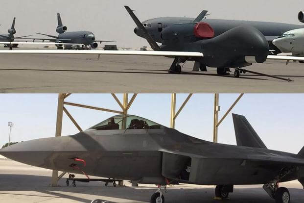 Military.com recently visited the 380th Air Expeditionary Wing at Al Dhafra Air Base, UAE. Seen here: RQ-4 Global Hawk on the flightline with KC-10s and an AWACS; and an F-22 stealth jet. (Photos: Oriana Pawlyk/Military.com)