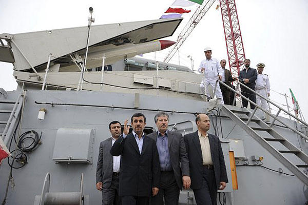 Iranian President Mahmoud Ahmadinejad, second left, waves, during the inauguration of the Jamaran-2 guided missile destroyer, in the port city of Anzali, about 150 miles (250 kilometers) northwest of the capital Tehran, Iran, Sunday, March 17, 2013.