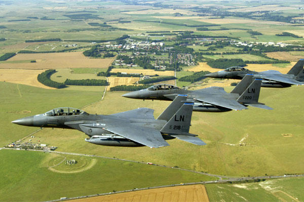 A trio of F-15E Strike Eagles from the 492nd Fighter Squadron at Royal Air Force Lakenheath, England, flies past Stonehenge.