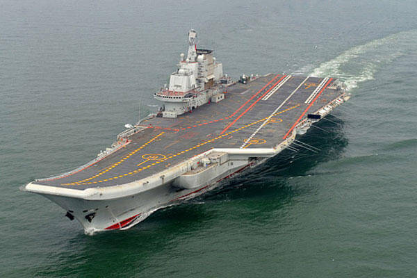 This May 2012 file photo provided by China's Xinhua News Agency shows the Chinese aircraft carrier Liaoning cruising for a test on the sea.