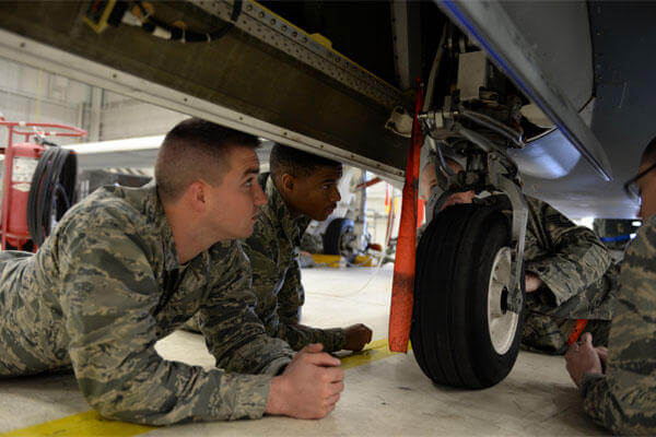 Airmen with the 372nd Training Squadron Detachment 21, inspect the landing gear of a RQ-4 Global Hawk Jan. 20, 2015, at Beale Air Force Base, Calif. (U.S. Air Force photo by Senior Airman Bobby Cummings)