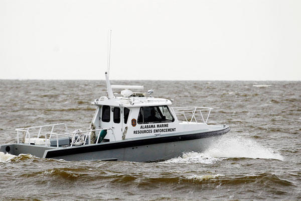 Search efforts continue for four people missing after a deadly weekend storm Monday, April 27, 2015, in Dauphin Island, Ala.  (Mike Kittrell/AL.com via AP)