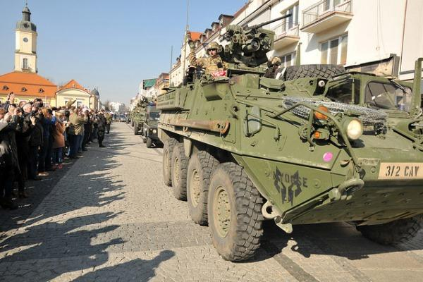 A Convoy Support Team from the 16th Sustainment Brigade and Lightning Troop, 3-2 Cavalry Regiment departs for the old city of Krakow on Mar. 24 during Operation Dragoon Ride. (U.S. Army photo by 1st Lt. Henry Chan)