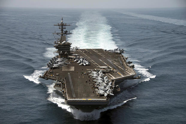 The aircraft carrier USS Theodore Roosevelt (CVN 71) operates in the Arabian Sea conducting maritime security operations.