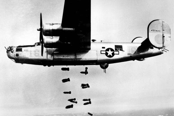 A consolidated B-24 Liberator of the 15th A.F. releases its bombs on the railyards at Muhldorf, Germany on 19 March 1945. (U.S. Air Force photo)