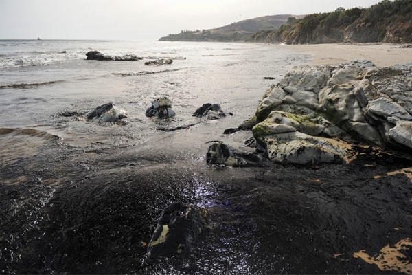An oil slick washes up on the shore Tuesday, May 19, 2015, near Goleta, Calif. (Kennth Song/The News-Press via AP)